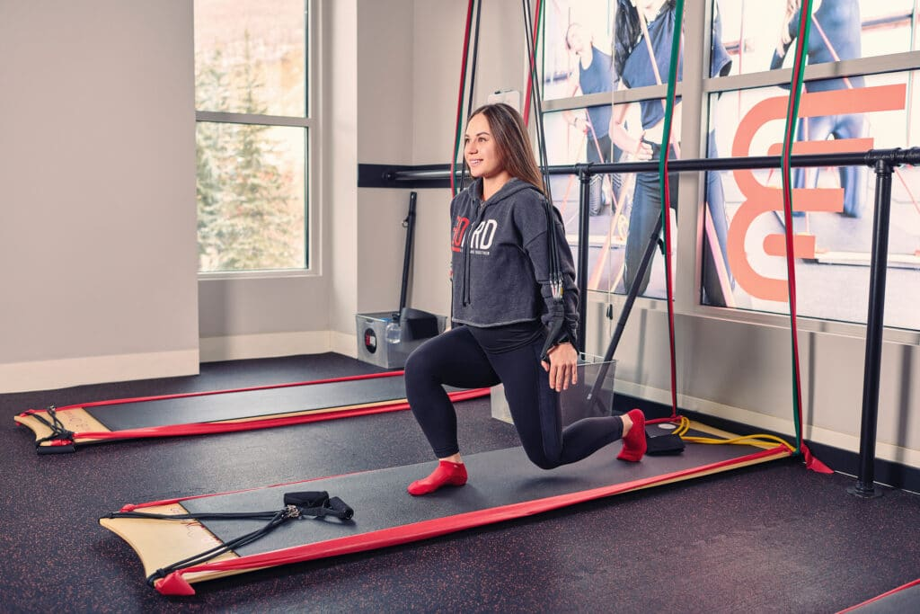 woman using the BOARD30 system to do a HIIT workout at BOARD30 Park City